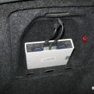 Блок разместили в штатном кармане багажника