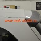 Оклейка автомобиля плёнкой - задний спойлер в чёрный цвет