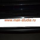 Защитная сетка радиатора над номерным знаком